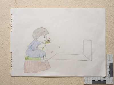 """A girl at her father's grave."" Drawing by Syrian girl."