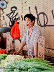 A vendor with vegetables.