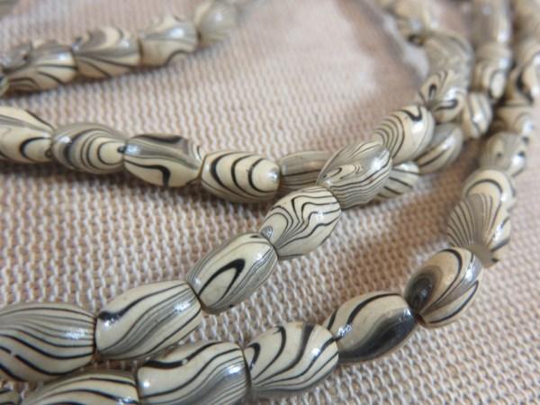 Perles ovale bois zébré 8mmx6mm ethnique - lot de 20