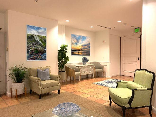 Aesthetic Practice Reception Area with Peaceful Landscape Photography