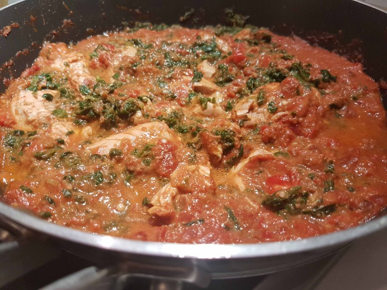 Chicken in a spicy eggplant red pepper sauce cooking