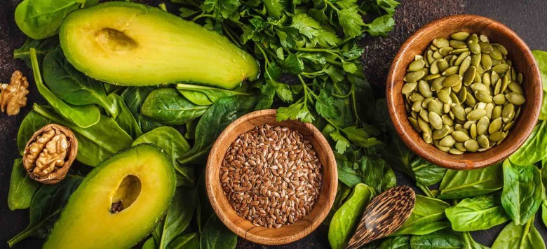Green salad. Vegan ingredients: spinach, avocado, flax and pumpk