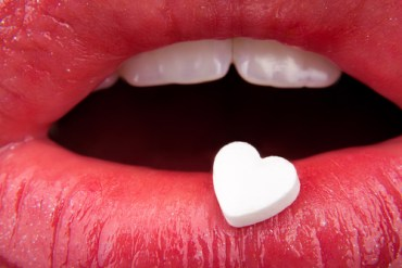 Heart kiss drug pill.