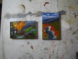 These are two completed acrylic paintings on miniature canvases.
