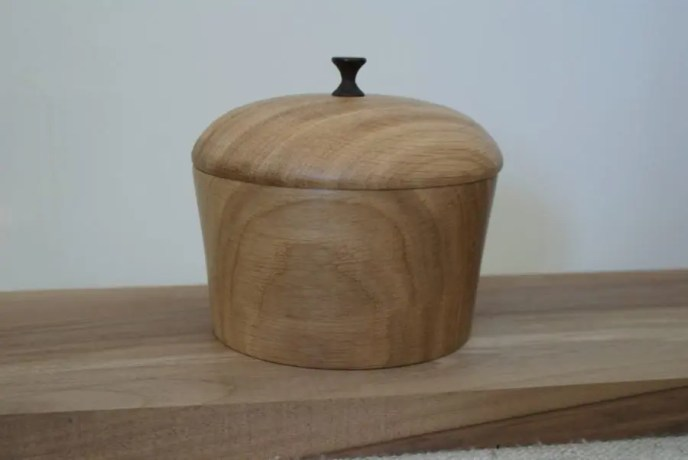 Oak woodturned box with a cocobolo rosewood tip on top