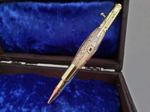 Historical wood and acrylic pen containing a piece of Independence Hall