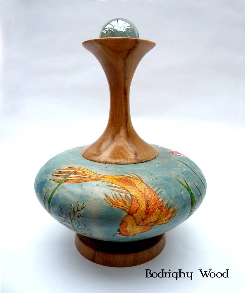 Woodturned vase from beech and lime wood decorated with koi pond painting