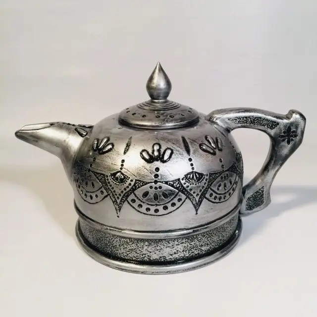 Wood teapot made to look like pewter.