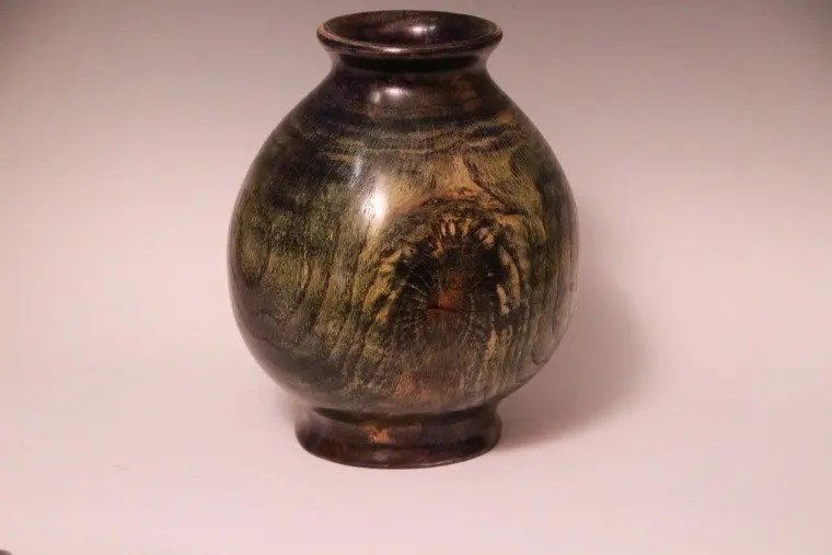 Vase wood turned from American Chestnut wood.