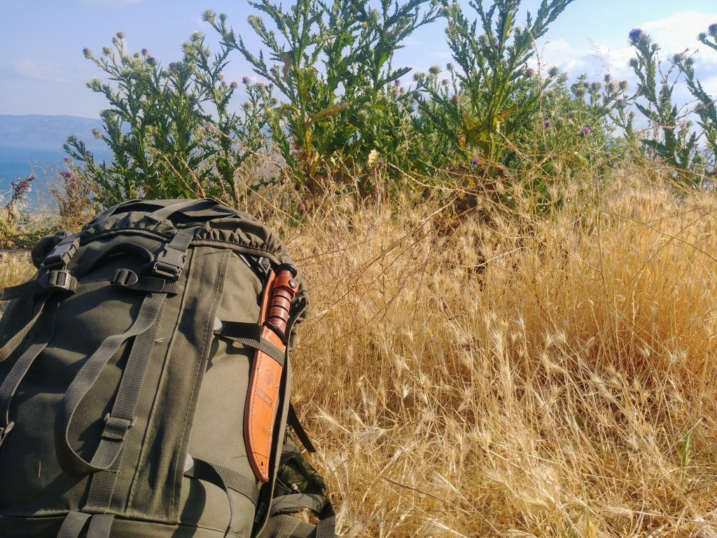 Backpack in the prairie grass at our campsite
