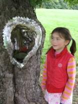 "'Tree Installation"" by Bettina Turner ( duct tape,spray paint. moss, sapling)"
