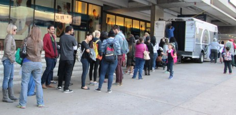 People waiting to use Inside Out Project photo booth at Back Bay Station
