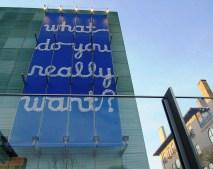 aluminum foil letters photographed against blue background