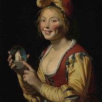 A smiling girl, a courtesan, holding an obscene image by Gerrit van Honthorst