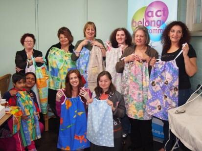 Participants showing off dresses