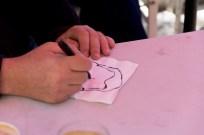 Chris drawing Simon 1. Photo by Rob Cox