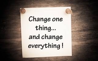 Flipchart with words: change one thing and change everything!