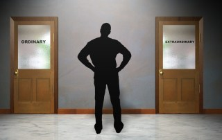 Image of man staring at two closed doors: one with word extraordinary and the other with ordinary