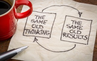 Napkin with the words: same old thinking, same old results