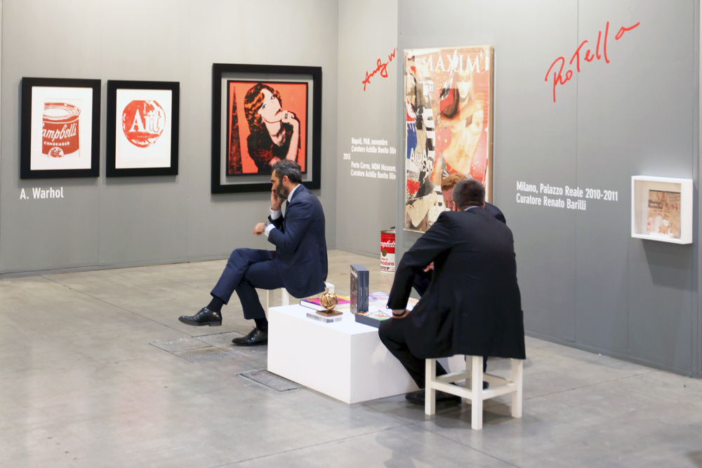 Two businessmen sitting in a museum gallery