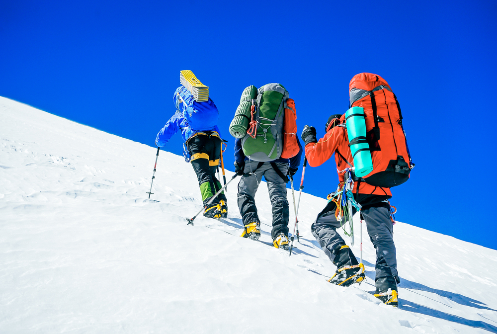 Image of three mountain climbers on mountain