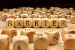 Letter tiles spelling out: Barrier