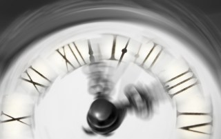 A blurred clock face connoting the passage of time