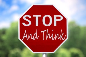 Stop sign with words: Stop and think