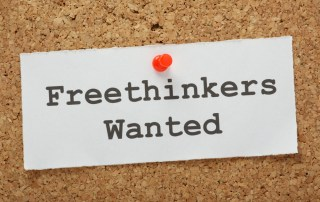 Note on cork board: freethinkers wanted