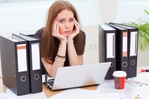 image of professional woman bored at work