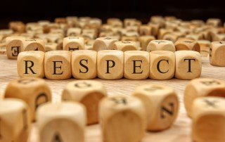 "wood tiles spelling out the word ""respect"""
