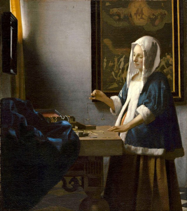 Vermeer woman holding a balance