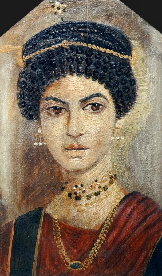Fayum portrait of a woman in a red tunic