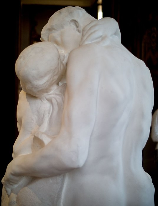 """Photo of a detail of the sculpture """"The Kiss""""."""