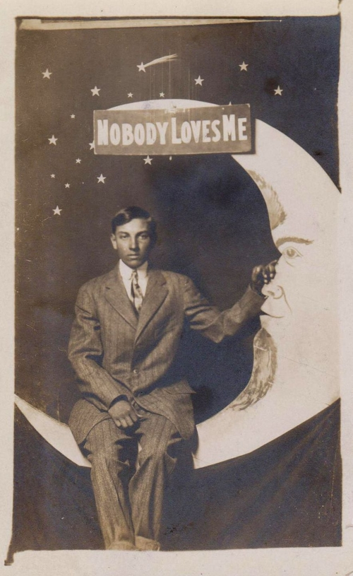 "Early 20th century ""paper moon"" souvenier photo."