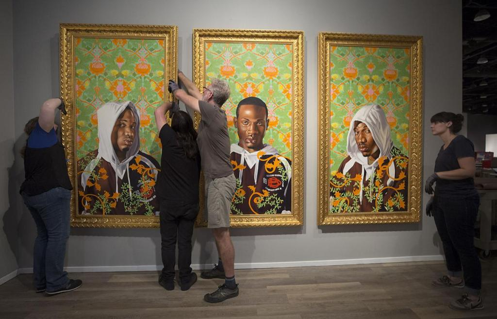 "Kehinde Wiley's ""Triple Portrait of Charles I"" are hung in the entrance to the Tucson Museum of Art on September 26, 2018. Mamta Popat / Arizona Daily Star"