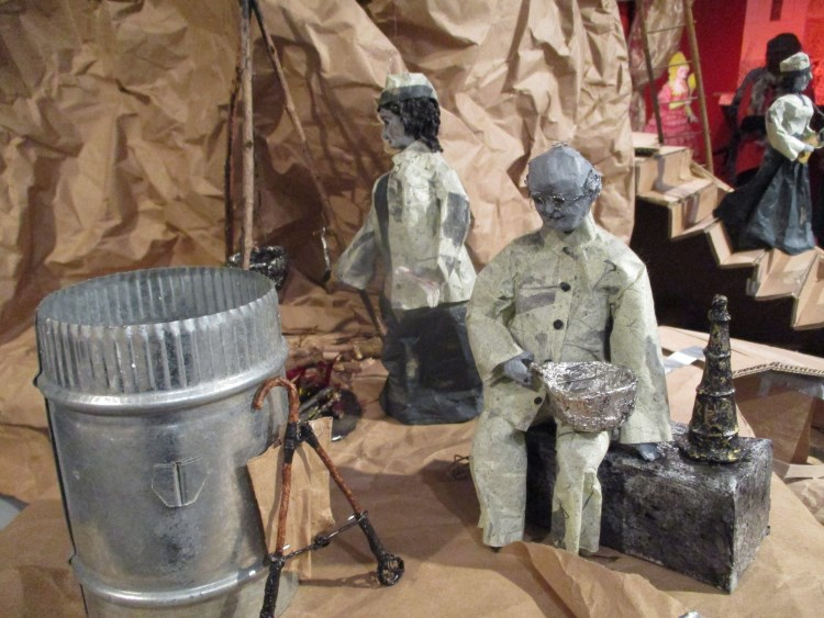 Installation view of COOK and SPECS from NEW GILDED AGE (2020-2021) by B. Lynch, College of the Holy Cross, Worcester MA. Figurines are 10 inches tall, mixed media.