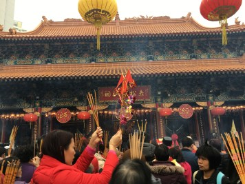 Putting incense in front of the deity's statue