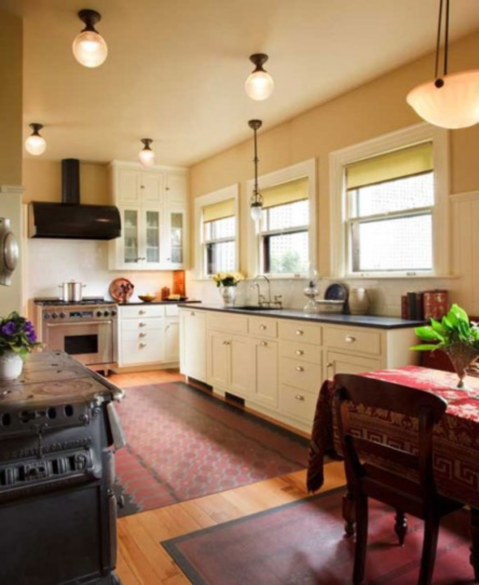 A Classic 1920s Kitchen   Design for the Arts   Crafts House   Arts     Owner Barbee Lyon is attached to the woodstove that came with the house   Floorcloths enhance