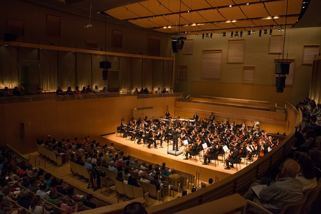 Concert hall with an orchestra on stage