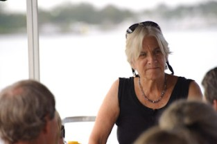 Betsy Damon speaking on special tour for community leaders aboard Sunshine Wildlife Tours