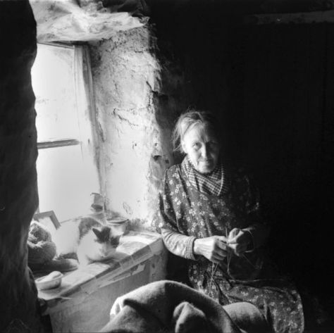 Woman in window, Harris, 1937. By Robert Moyes Adam. Courtesy of the University of St Andrews Library: RMA-H-5591.X.
