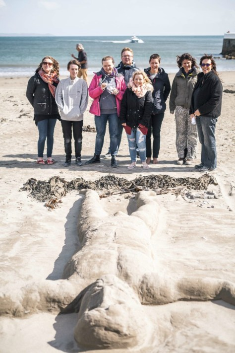 BA (Hons) Extended Degree students from Plymouth College of Art creating sand sculptures on Looe beach - Photo by Taylor Harford