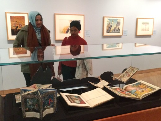 Antique illustrated books on display