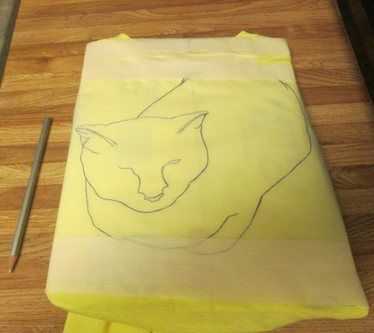 The tracing paper was taped to the shirt with masking tape. A pencil was used to transfer the image on to the shirt.