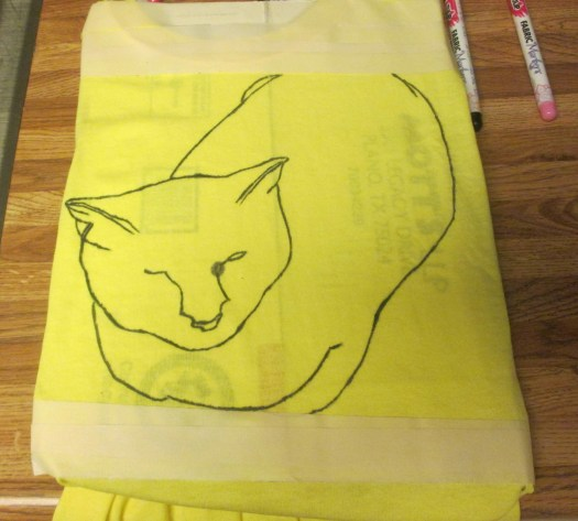 A black fabric marker was used to outline the drawing of Irina the cat.