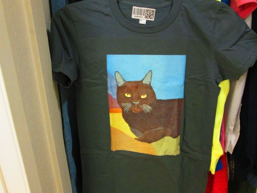 The charcoal grey shirt has a reprint of my Irina the cat painting.