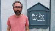 Nathan Golub alongside Yep Roc Records sign