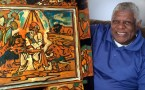 """Artist Rudolph Bostic with his painting """"In the Lion's Den"""""""