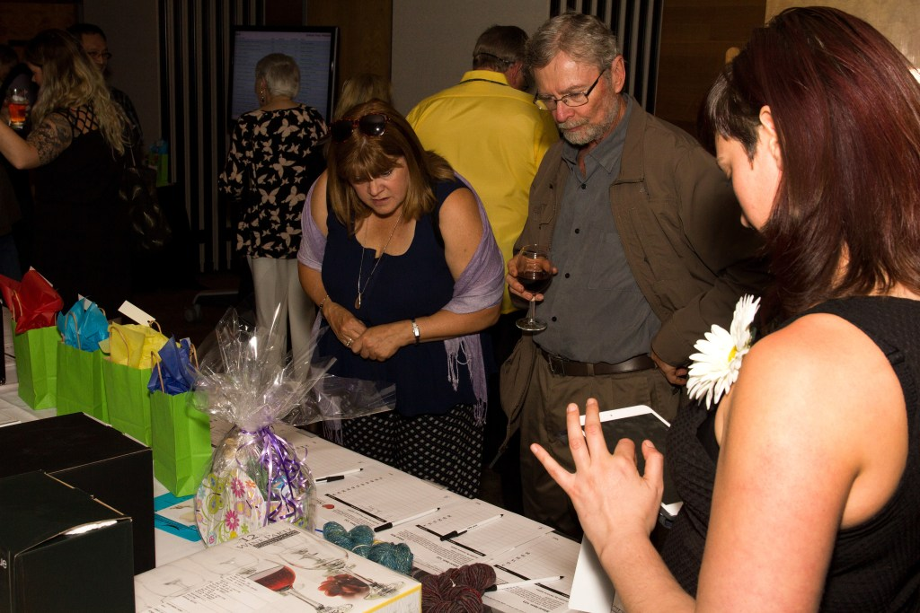 Guests bid in the silent auction at Colour Your Palate.